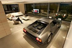 """A living space where my vehicles can rest too!     """"People in L.A. care so much about their cars and then the cars wind up stuck out in garages,"""" says Schubert, whose garage truly brings the car into the living space.    Back to L.A. at Home design blog"""