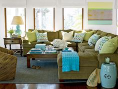 Sectional and large coffee table configuration. *Bonus...full length windows and lots of light in the room.
