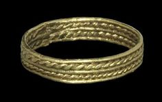 Saxon Gold Ropework Finger Ring 6th-8th century AD . A filigree finger ring formed from two twisted wire bands framed by three plain wires.