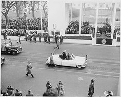 President Dwight D. Eisenhower and First Lady Mamie Eisenhower waving to crowds as they ride in the Inaugural parade., 1/20/1953