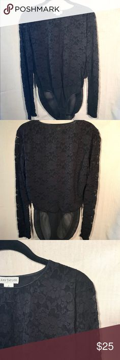 """Ann Taylor Black Lace Bodysuit This beautiful Ann Taylor Black lace bodysuit is in a stretch fabric with snap closure. Fully lined torso with open lace sleeves. Excellent used condition, worn once. Carefully note measurements as shown:  Approximate measurements: Shoulder to shoulder: 15"""" Shoulder to snap crotch: 28"""" Shoulder to wrist: 24"""" Armpit to armpit: 19"""" Ann Taylor Other"""