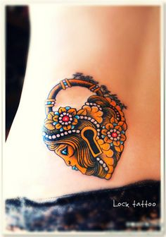 a lock tattoo on the hip with Egyptian style of decoration #lock #tattoo