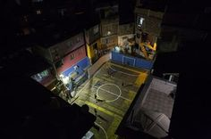 """In this Thursday, June 5, 2014 photo, people play soccer at the Tavares Bastos slum in Rio de Janeiro, Brazil. Whether professional-grade or improvised, in high-rent neighborhoods or tucked into """"favela"""" hillside slums, soccer fields are literally everywhere throughout this chaotic ... (AP Photo/Felipe Dana) ▼10Jun2014AP AP PHOTOS: Soccer fields are everywhere in Rio http://bigstory.ap.org/article/ap-photos-soccer-fields-are-everywhere-rio #Rio_de_Janeiro #Tavares_Bastos_slum"""