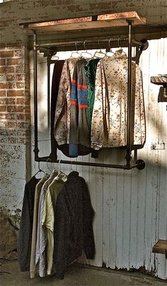 "Industrial Garment Rack Hanging. Use this concept for the ""Hutch"" attached to the ceiling"