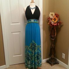 Black and Aqua maxi Very pretty black top with turquoise bottom and multi color hem and waist. NWOT Dresses