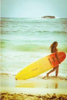 Surfer Girl. Longboarding. Beach.