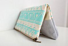 triangle printed leather-suede pouch aqua by coriumi