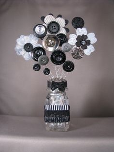 """This one has a vintage shaker and is a lot heavier and larger than most, which is why it has a higher shipping cost.  ~~~~~~~~~~~~~~~~~~~~ I love creating what I call my """"Button-Lee"""" Bouquets. They measure anywhere from 2-10 in height. Prices range from $3 to $75. Each one I make, I take great pride in. It takes days to create them. I want them to be beautifully appealing to the eye. They look great anywhere! Your desk. On a bookshelf or mantel. They can make great gifts for young ones and…"""