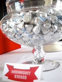 """Set out a bowl of hersey kisses marked """"midnight kisses""""! Not only super easy, but chocolate goes great with champagne"""