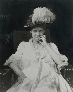 Elsie Bell Grosvenor stares straight at the camera in this portrait taken in 1901, possibly when she was pregnant with Melville B. Grosvenor. She is wearing a hat decorated with a huge ostrich...