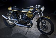 Great looking RD350!  I like the seat/tail and the colors.