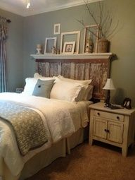 5 panel door turned into headboard for a queen or king-sized bed frame. love the frames and twigs on the shelf!