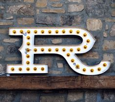 """I love old neon signs.  I wish this """"R"""" was on my mantle :) Via Design Sponge."""