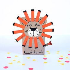 Sleepy lion gift wrap. Simple and cute lion gift wrapping. | Let's Wrap Stuff  http://letswrapstuff.com/sleepy-lion-gift-wrap/