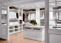 CLOSET DRESSING Closet and Wardrobe Designs. Beautiful white and classic walk-in closet with amazing wooden center table with drawer unit, nice shelvings and tall hanging. Fancy Dream Home Interior Walk-in Closet Designs Closet Walk-in, White Closet, Closet Space, Closet Storage, Closet Ideas, Closet Organization, Ikea Closet, Organization Ideas, Smart Closet