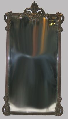 1920's brass and iron mirror