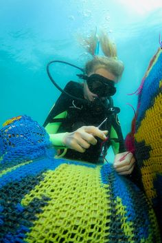 Yes Olek is crocheting UNDERWATER. And yes, the yarn is biodegradable.