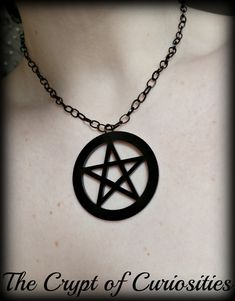 WAS £8.00, NOW JUST £6.50 A stunning black acrylic pentacle charm hangs from black plated chain. Charm measures approx 1.9 x 1.9  Lead and nickel free Chain measures approx 14 inches long with added 2 inch extender finished with black glass crystal beads. Please add a note to your order if you require a longer extender chain.    PLEASE NOTE THE STORE IS UK BASED, ANY INTERNATIONAL ORDERS WILL TAKE LONGER TO ARRIVE WITH YOU. THIS CAN BE UP TO 6 WEEKS. PLEASE WAIT UNTIL THIS TIME HAS PASSED…