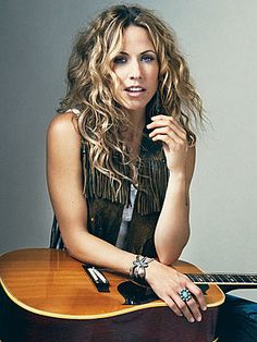 Sheryl Crow - Saw her in concert in Sept. 2008 where I made eye contact with her. She is environmentally conscious and her song lyrics are awesome.