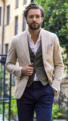 Fall fashion inspiration with a white button up shirt military green waistcoat cream blazer gray linen pocket square navy trousers. model unknown.  #blazer #waistcoat #businesscasual #menswear #mensfashion #menstyle #fallfashion #falloutfits