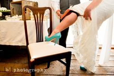 So... here's something unique for you! I didn't want a garter, because - quite frankly- I have always found the garter toss awkward for everyone. Instead I had the knife my Uncle hand-made for me as a wedding gift on my leg! It was great seeing the reactions as I pulled up my dress, revealing my blue high heels,  only to pull a fancy knife out of its sheath to cut the cake with!!