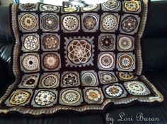 Block 9 - Circles of the Sun CAL | LillaBjörn's Crochet World - Here is an afghan made by Lori Baran. She joined Circles of the Sun with other squares and look what a beauty it is!