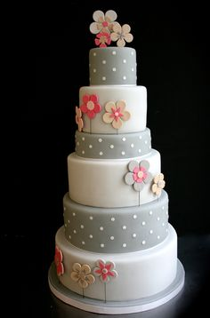 Greys and pink for a wedding cake.  Alternating tiers of white and gray with dots.  Pink and gray flowers