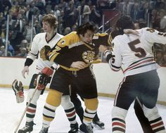 """siphotos: """" Phil Esposito and Phil Russell drop the gloves (with Keith Magnuson in the background) during a 1974 Bruins-Blackhawks at Chicago Stadium. Stars Hockey, Ice Hockey Teams, Mlb Teams, Hockey Players, Hockey Stuff, Sports Teams, Boston Bruins Hockey, Chicago Blackhawks, Nhl Wallpaper"""