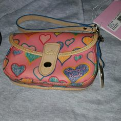 Dooney & Bourke nwt pink heart clutch New with tags pink Dooney & Bourke heart it clutch! Super cute. Feel free to ask any questions :) my purses are all authentic usually purchased from macys or sometimes directly from the actual dooney or coach website. Dooney & Bourke Bags Clutches & Wristlets