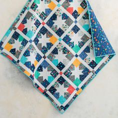 Charmburst Space Camp Quilt Kitby Craftsy featuring Lily & Loom Space Camp. Charm square quilt kit creates fun stars. #starquilt #charmquilt affiliate link.