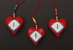 "Ulla Anobile: BEE HEART ornaments. 2"" x 2"", hand stitched felt, embroidery floss, polyfill, beads. All SOLD"