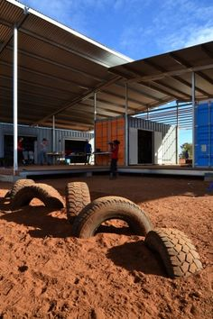 Masters students from the University of Melbourne's Faculty of Architecture, Building & Planning worked with the Gumala Aboriginal Corporation to build an early childhood learning center in the Pilbara region of Western Australia this past June. Tyres create good (and cheap) play structures.
