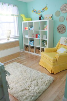 I wish I had white baby furniture for Violet's room instead of teak! Love the yellow, aqua with white.