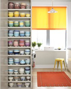 Take a look at our 'Kitchen Novelties' Pin Board. This kitchen has built-in space for its owners' colorful cafe au lait bowl collection.