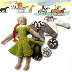 Lovely knitted dolls with yoked sweaters and matching berets