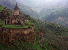 """The Tatev Monastery is a monastery located on a large basalt plateau near the Tatev village in Syunik Province in southeastern Armenia. The term """"Tatev"""" usually refers to the monastery. Places Around The World, Oh The Places You'll Go, Places To Travel, Places To Visit, Around The Worlds, Dark Places, Beautiful World, Beautiful Places, Beautiful Castles"""