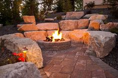 Spokane & Coeur d'Alene Backyard Fire Pit Design & Construction Cool Fire Pits, Diy Fire Pit, Fire Pit Backyard, Sloped Backyard, Backyard Landscaping, Backyard Seating, Backyard Ideas, Outdoor Fire, Outdoor Living