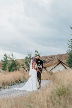 Boho styled wedding shoot with bride and groom in white lace dress with long train and black suit in Logan Utah by Kristi Alyse Photography. wedding inspo white lace dress long train purple hair black suit wedding and family photographer quality photography logan utah meaningful photography boho bohemian wedding #northernutahweddingphotographer #loganutahweddingphotographer #meaningfulphotography #bohowedding #bohoweddingdress #utahweddings #utahbride #love #outdoors #weddings