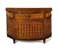 A Fine Piedmontese 18th century walnut and fruitwood marquetry demi-lune chest.