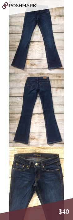 Levi's Dark Wash Bellbottom Flare Jeans Dark wash Levi's low waist flare jeans in size 1. Like new condition! Please comment with questions or requests for measurements :) Levi's Jeans Flare & Wide Leg