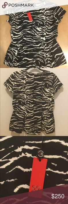 Carolina Herrera Zebra Print Peplum Top This beautiful designer top is perfect for any elegant event or date night. Wear it with tailored pants, heels, and a clutch. This is in brand new, perfect condition. Carolina Herrera Tops