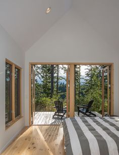 In the master bedroom, Douglas firs filter the light and mountain views for a more intimate experience.