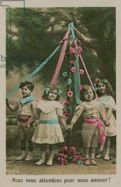 May Day Celebration (May 1st) :Dancing around the Maypole. This is a postcard of children standing around a maypole, sent in 1913. Was a holiday celebrated in most of the world ,in the early 1900s.