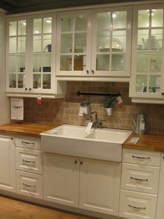 Love this! Drop in apron front sink and butcher block counter tops!
