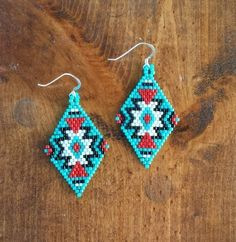 Adorable native design earrings. Made with glass seed beads on sterling silver hooks.