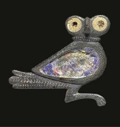 The owl facing right with head turned to the front, large circular eyes and projecting beak, the body recess with remains of blue inlay, the eyes with weathered glass pupils. Roman Jewelry, Old Jewelry, Jewelry Art, Antique Jewelry, Renaissance Jewelry, Medieval Jewelry, Ancient Jewelry, Roman Goddess Of Love, Roman Britain