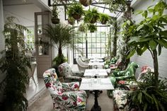 The architects and interior designers have created a stunning restaurant space that is reminiscent of an abandoned overgrown country house, with trailing vines and wrought iron garden chairs.   The café area has more of a mid-century club lounge feel, with high backed velvet sofas surrounding a huge marble-topped bar where signature cocktails are served up with finesse.  42 Northampton Rd, London EC1R 0HU, United Kingdom  Check out more info…
