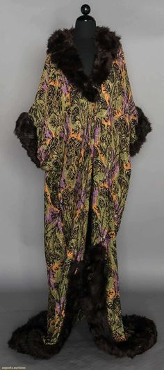 PRINTED LAME COCOON COAT, c. 1912 Green, purple & yellow print w/ gold lame brocade, fur trimmed collar & sleeves, 1 hole in folds above side hem Rococo Fashion, Edwardian Fashion, Art Deco Fashion, Vintage Fashion, Corsage, Vintage Costumes, Vintage Outfits, Opera Coat, Cocoon Dress
