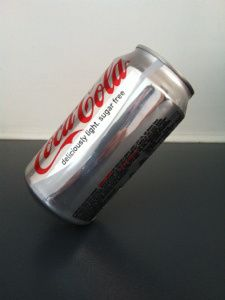 Simple science experiment for kids. Make a can balance on its edge.