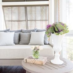 Fresh kale and felt pillows scream fall! This porch is nothing but the best for the season in The Low County. @kelliboydphotography @palmettobluff @janusetcie @perennialsfabrics #kelliboydphotography #perennialfabrics #palmettobluff #ashe #janusetcie